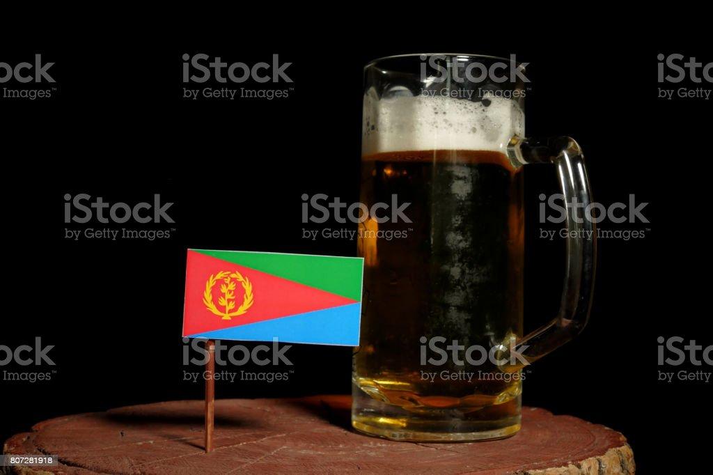 Eritrean flag with beer mug isolated on black background stock photo