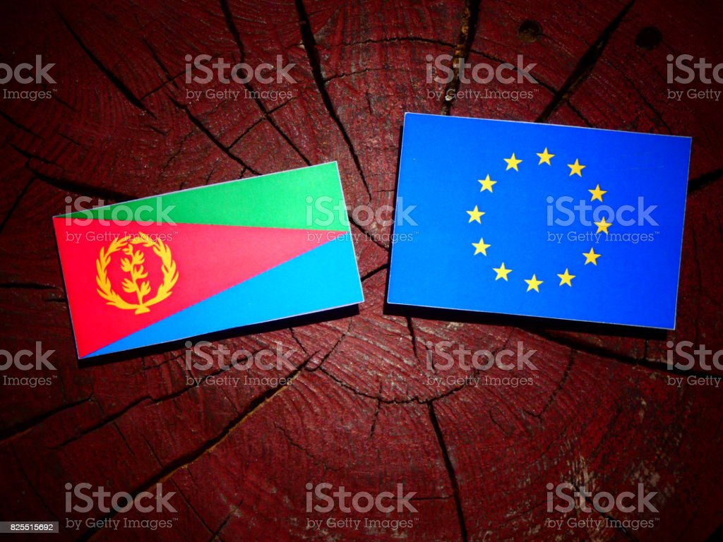 Eritrean flag with EU flag on a tree stump isolated stock photo