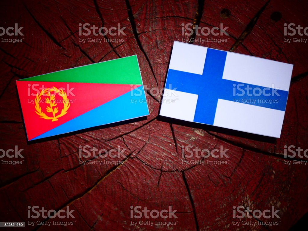 Eritrean flag with Finnish flag on a tree stump isolated stock photo