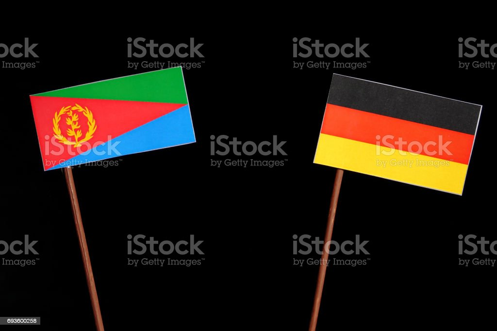 Eritrean flag with German flag isolated on black background stock photo