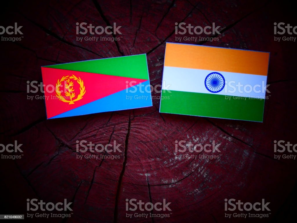 Eritrean flag with Indian flag on a tree stump isolated stock photo