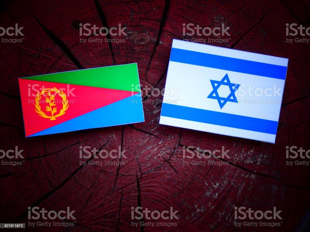 Eritrean flag with Israeli flag on a tree stump isolated stock photo