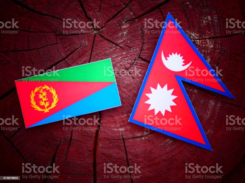 Eritrean flag with Nepali flag on a tree stump isolated stock photo