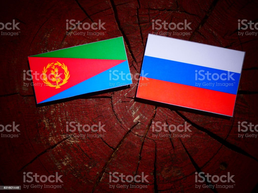 Eritrean flag with Russian flag on a tree stump isolated stock photo