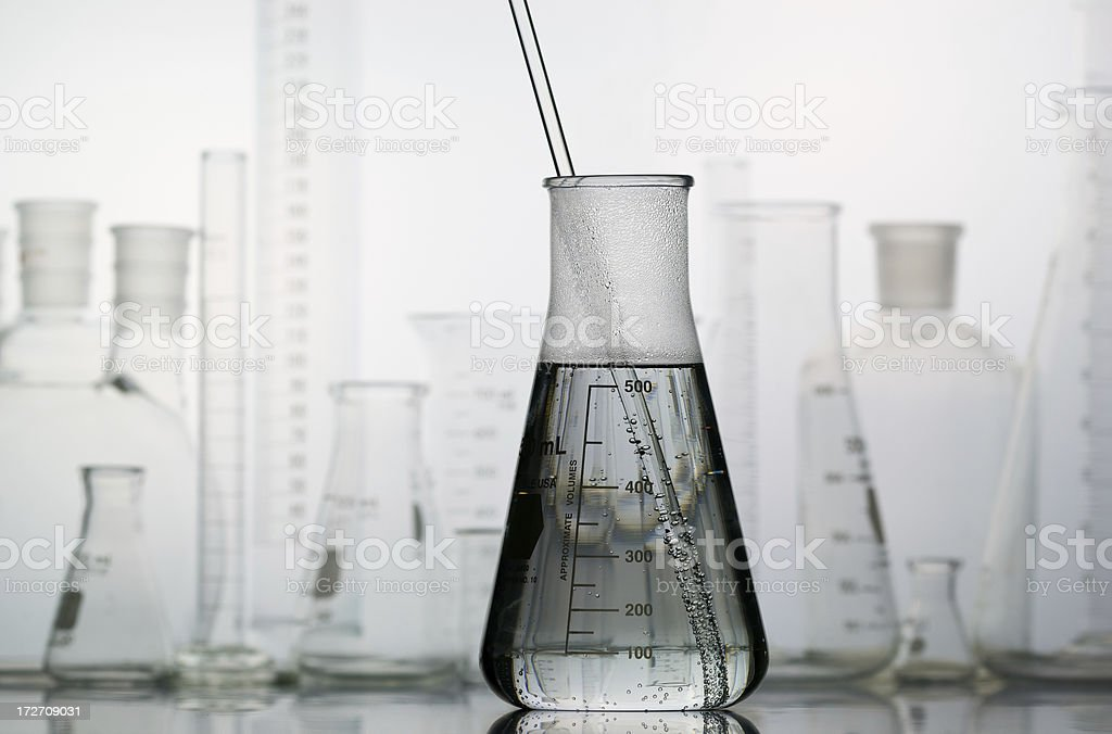 Erlenmeyer Flask with Laboratory Glassware in the Background stock photo