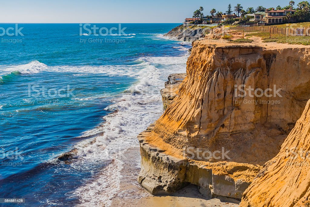 Eroded cliff of Carlsbad with breaking surf, CA stock photo