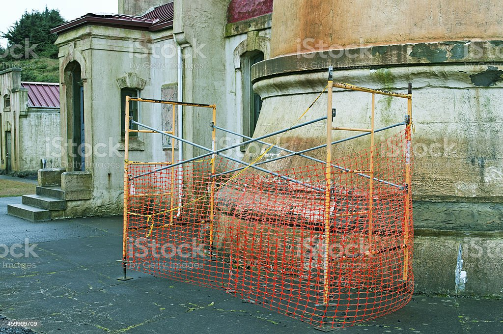 Eroding stone at base of lighthouse in service since 1898 royalty-free stock photo