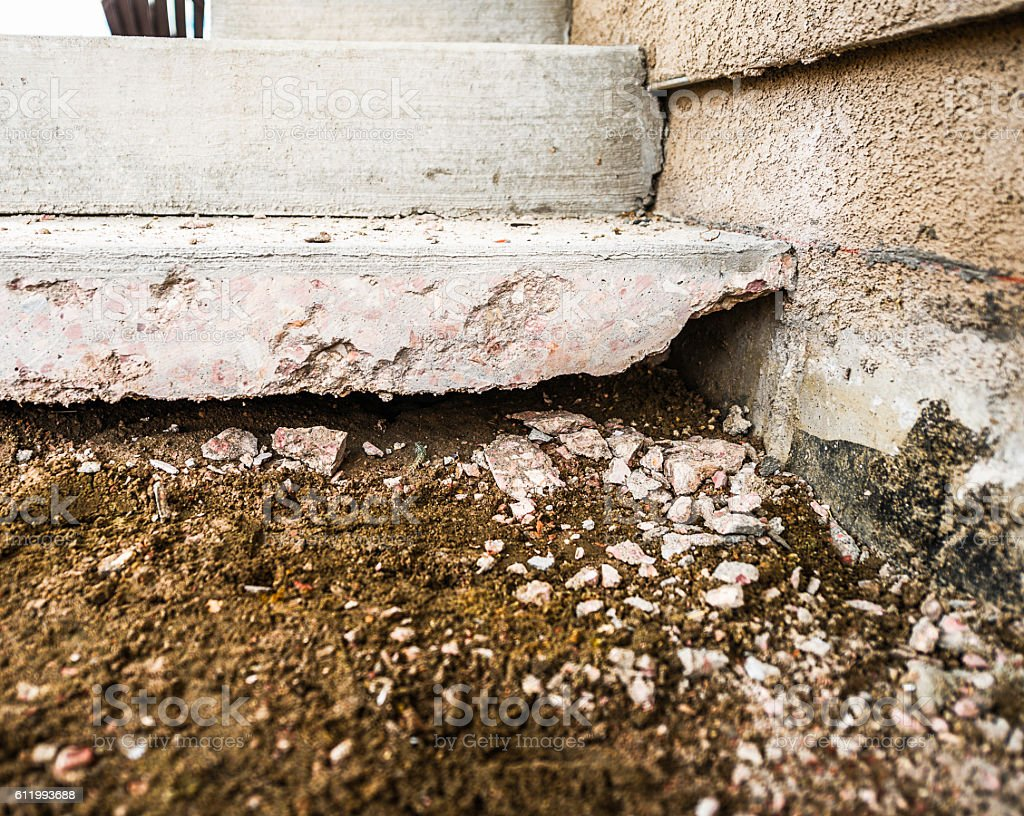 Erosion And Settlement Of Home Foundation Under Removed Patio Royalty Free  Stock Photo