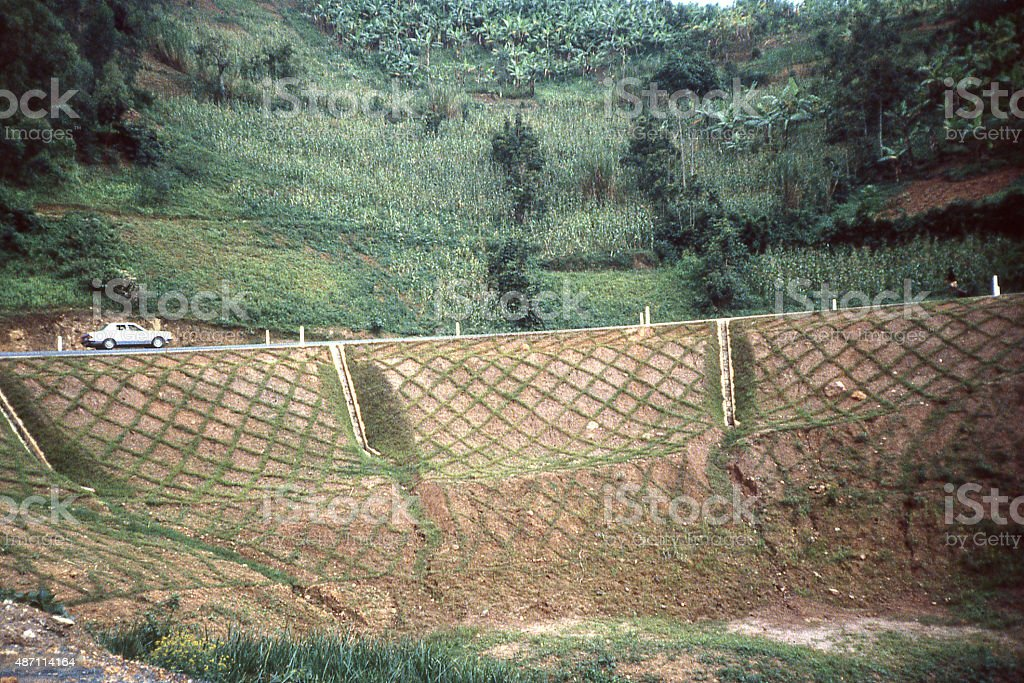 Erosion control steep slopes mountain highway central highlands Rwanda Africa stock photo