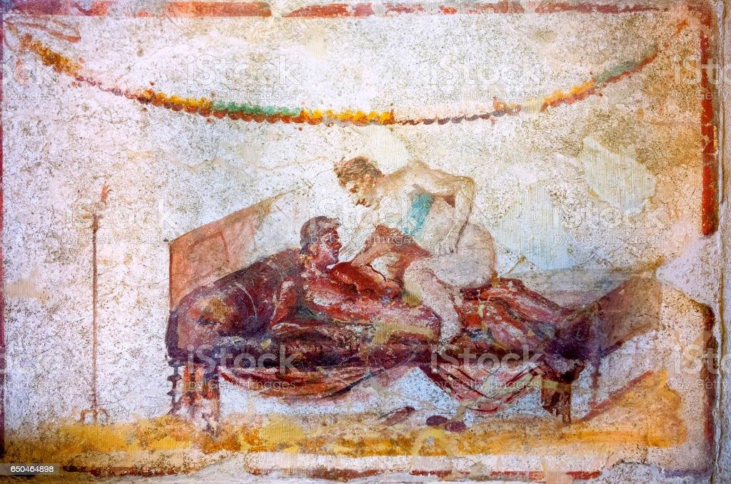 Erotic art in Pompeii. Ancient Roman fresco in Pompeii brothel stock photo