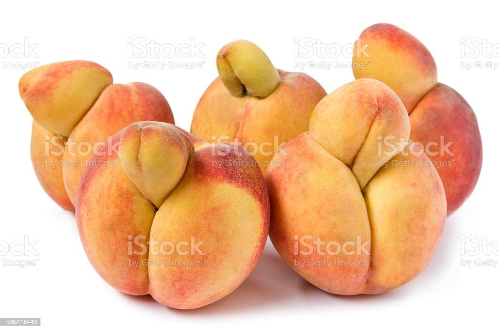 Erotic Peaches, strange growth like penises, on white stock photo