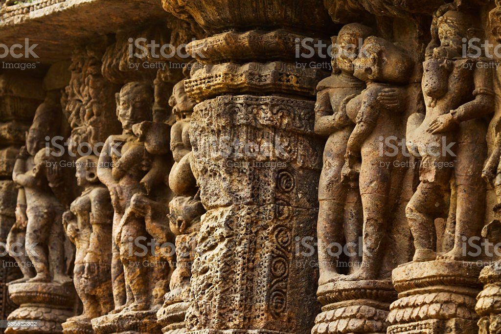 Erotic sculptures on temple wall in India stock photo
