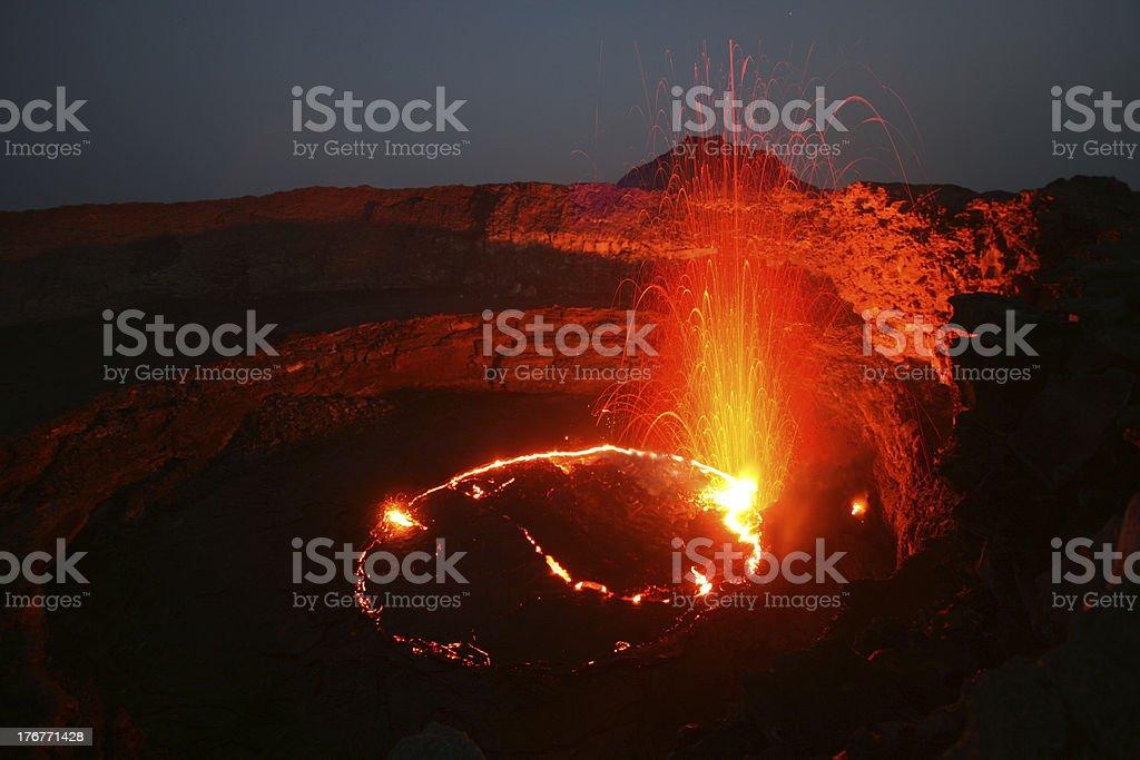Erta Ale volcano with eruption stock photo
