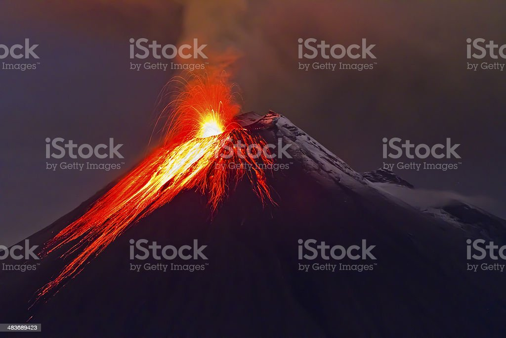 eruption of the volcano with molten lava stock photo