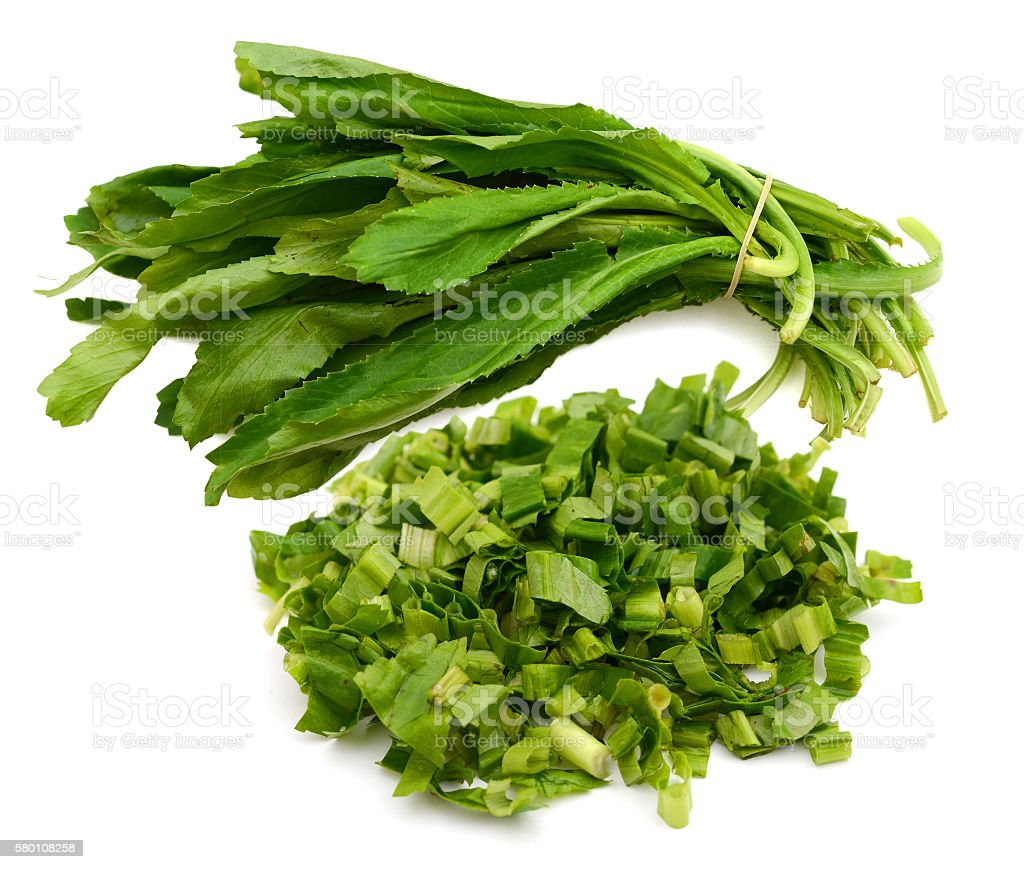 Eryngium foetidum or long coriander leaves with chopping stock photo
