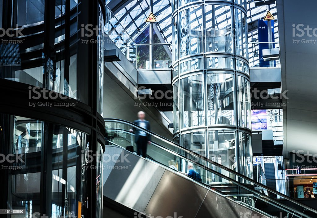 escalator and elevator in modern railway station stock photo