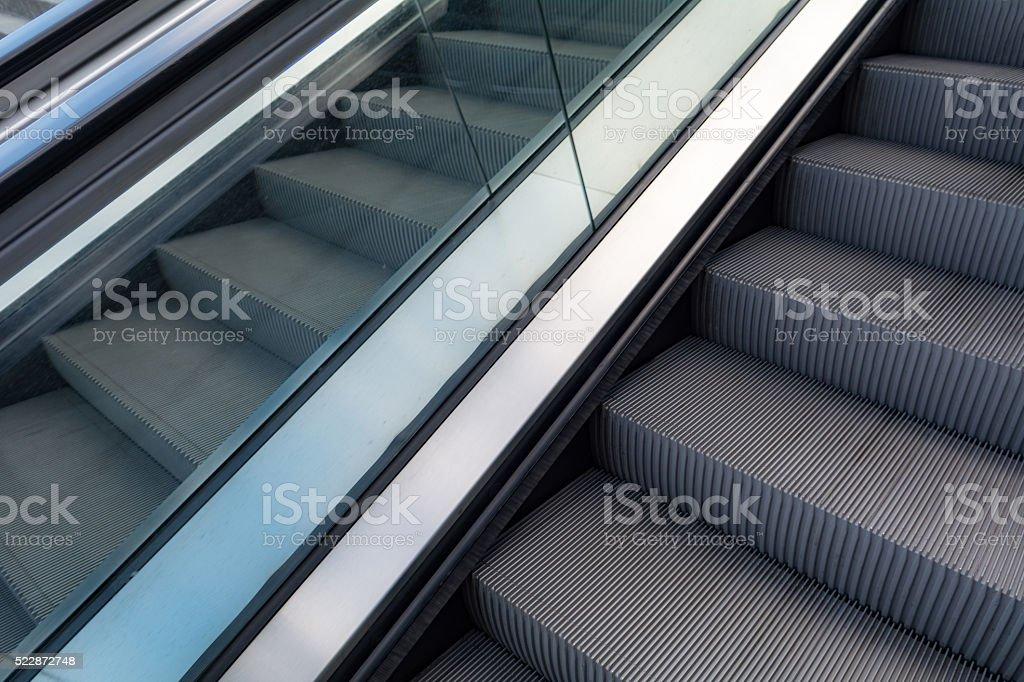 Escalator background with glass panel stock photo