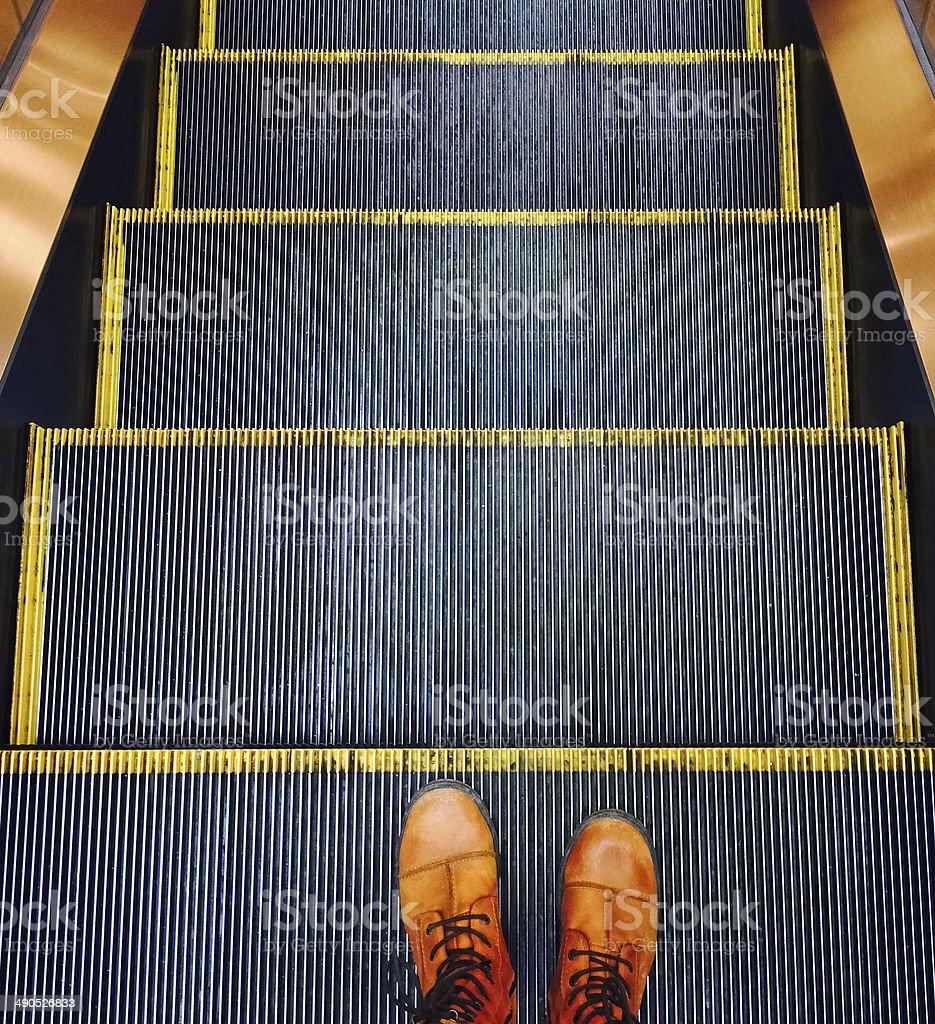 Escalator going down stock photo