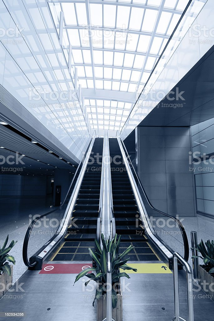 Escalator in Modern Building royalty-free stock photo
