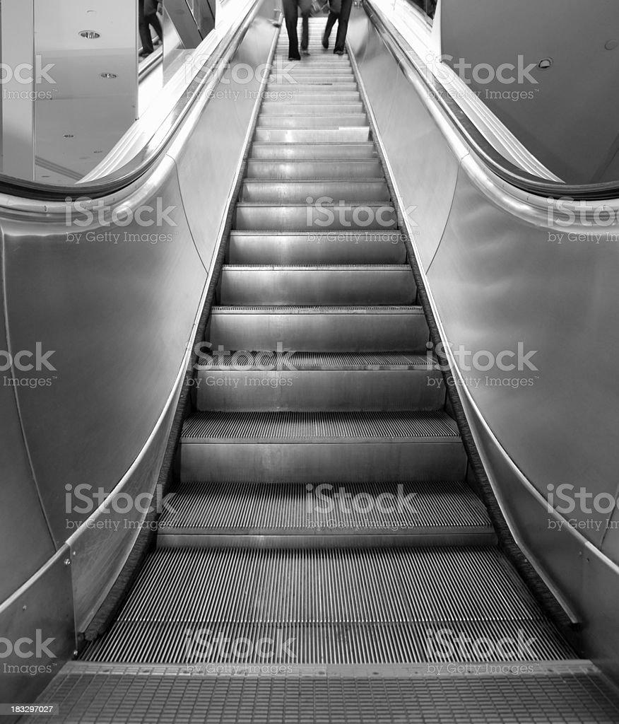 Escalator in monotone royalty-free stock photo