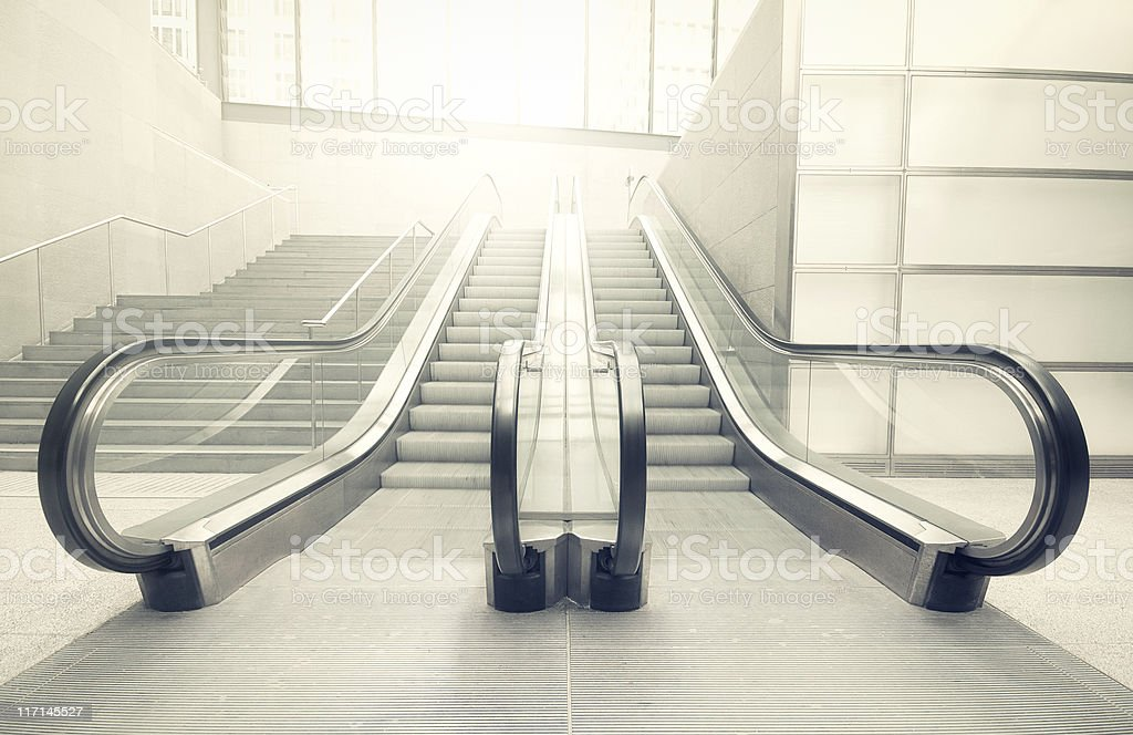Escalator in the sun stock photo