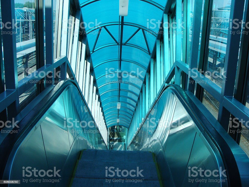 Escalator Inside the Concourse at a Modern Railway Station stock photo