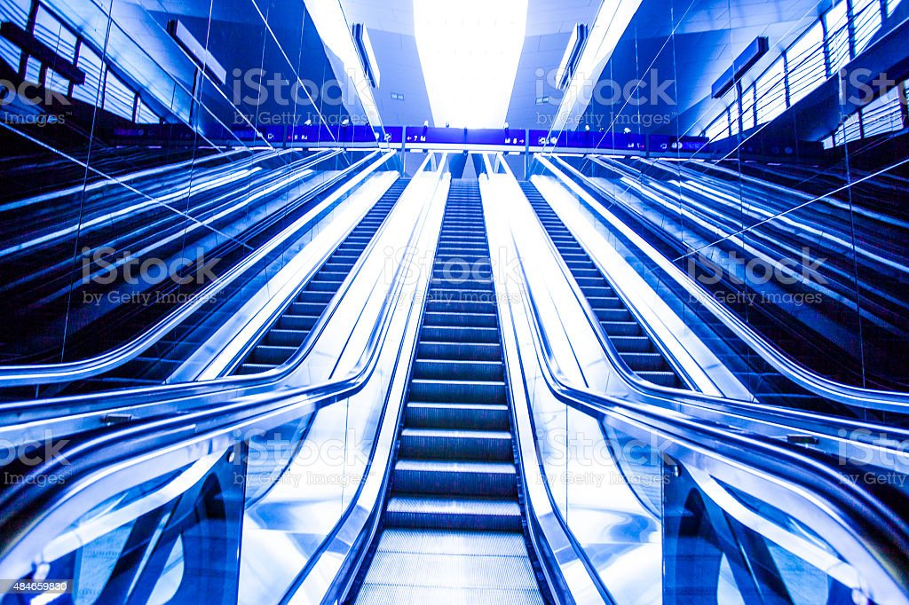 escalator on train station, view in blue tone.motion blur stock photo