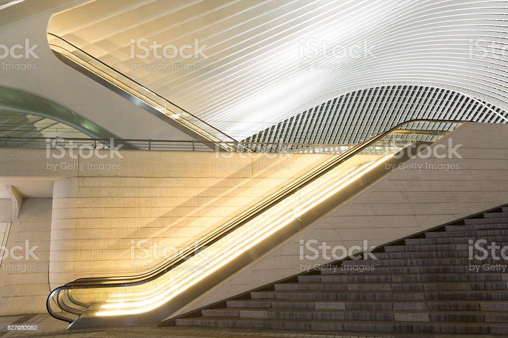 Escalator Outside Futuristic Train Station Illuminated at Night stock photo