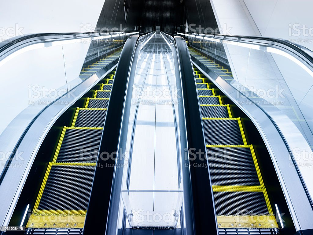 Escalator Stairs Up and Down in Interior Building stock photo
