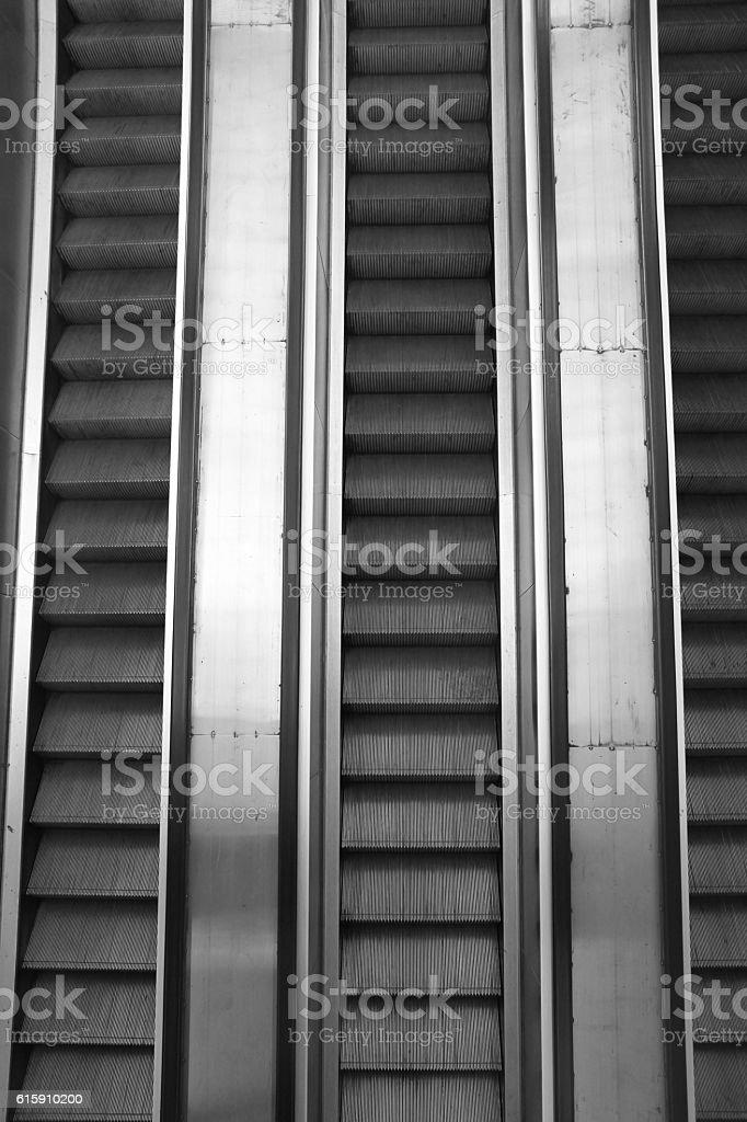 Escalator step moving up