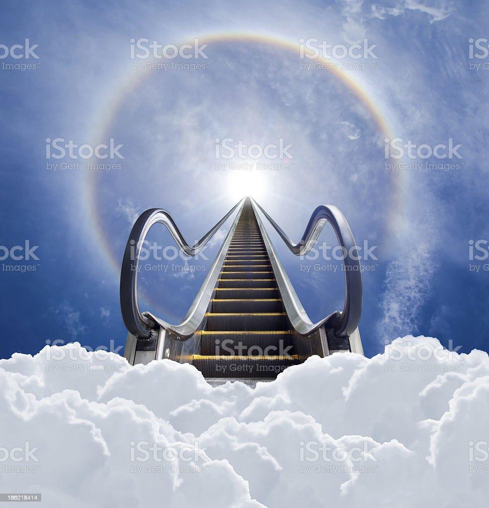 escalator to sun halo and cloudscape stock photo