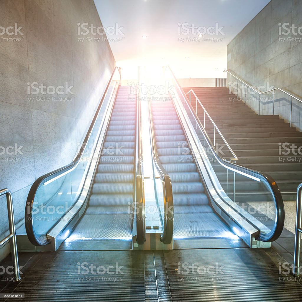 Escalator with sunlight stock photo