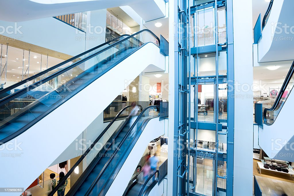Escalators and elevator in shopping center royalty-free stock photo