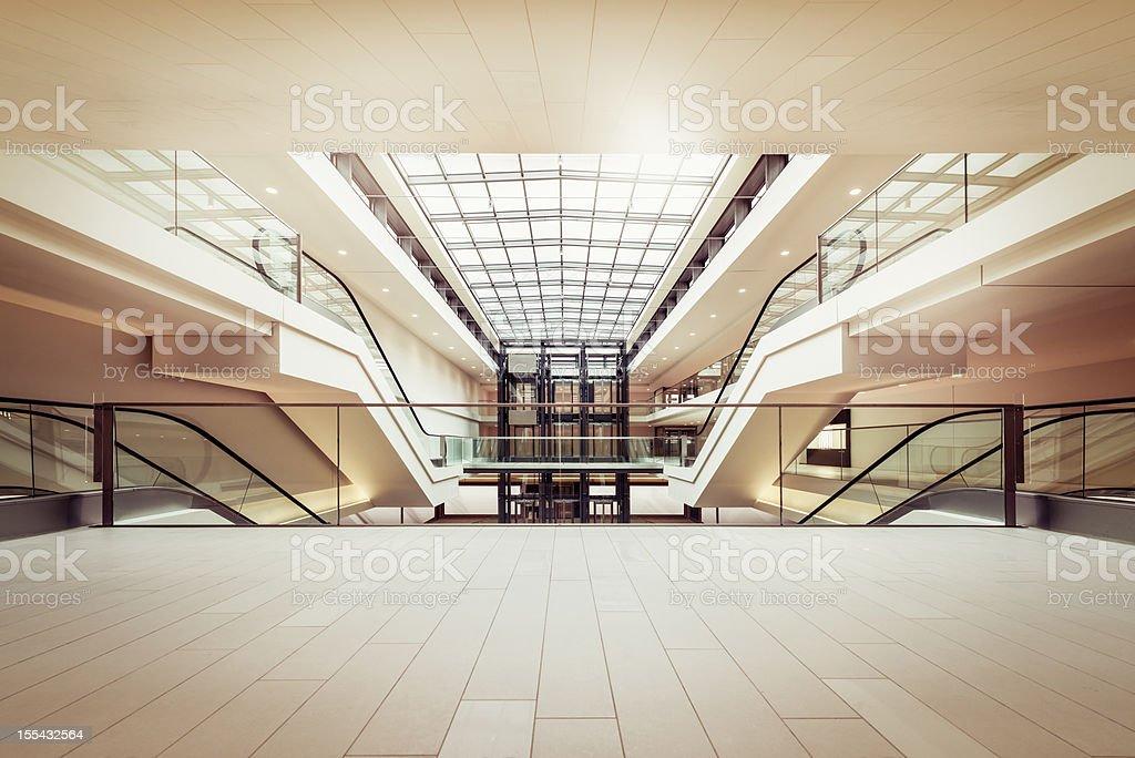 Escalators in a clean modern shopping mall stock photo
