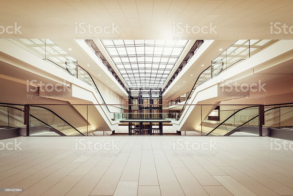 Escalators in a clean modern shopping mall stock photo