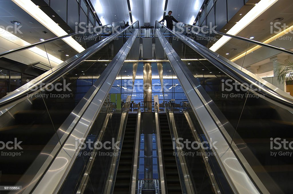 Escalators in airport royalty-free stock photo