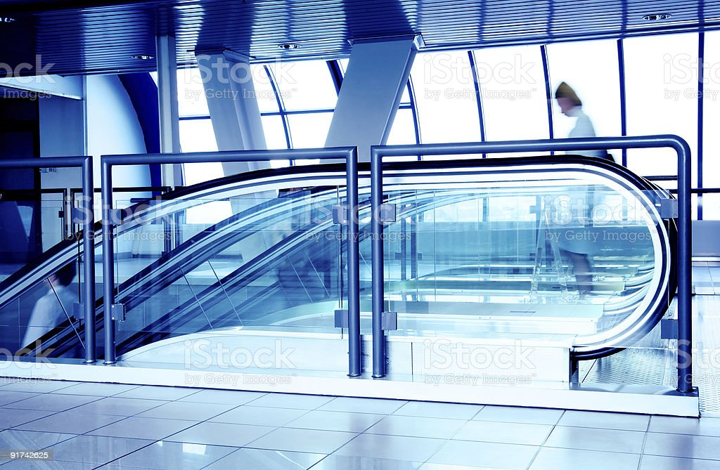 Escalators in modern business center royalty-free stock photo