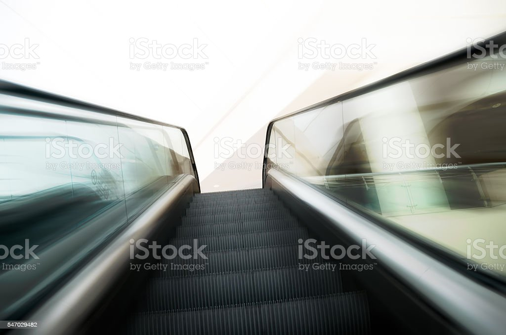 Escalators stairway inside modern building going up zoom in stock photo
