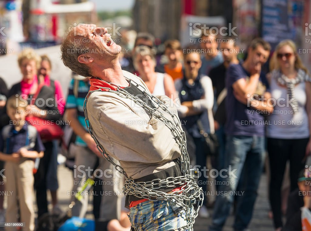Escape artist performing on the street stock photo