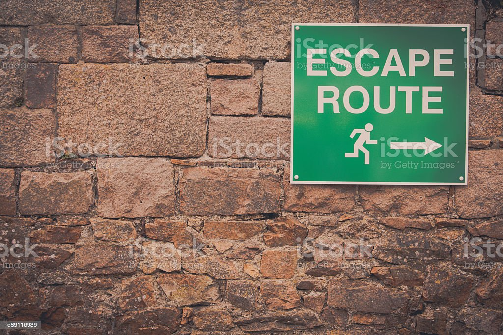 Escape route indicator stock photo