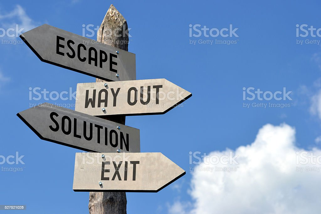 Escape, way out, solution, exit signpost stock photo