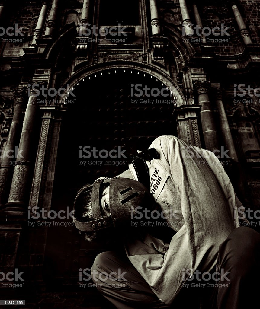 Escaped mental patient in front of an asylum stock photo
