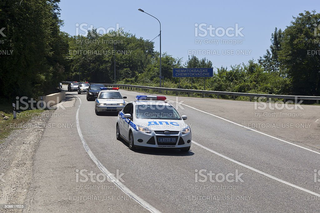 Escort of police cars on road stock photo