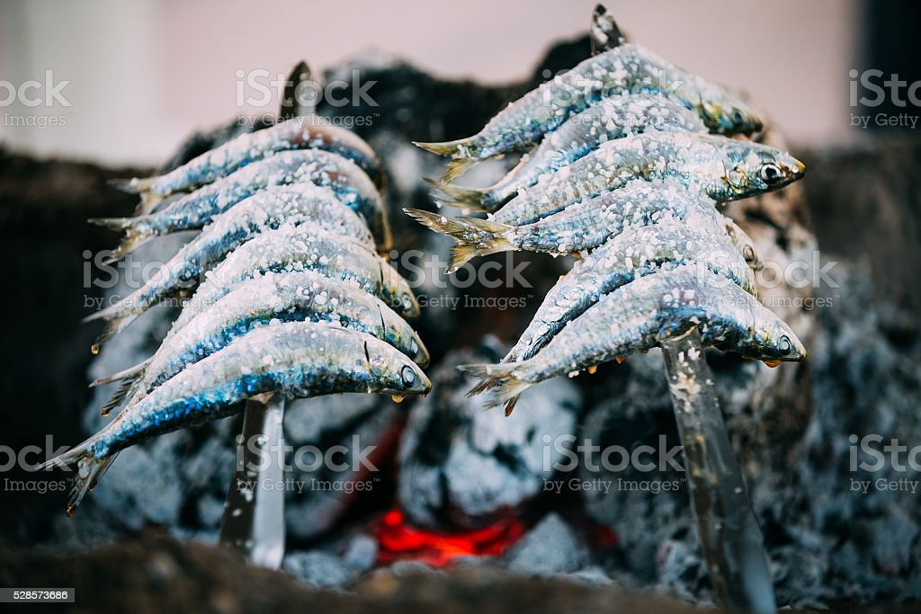 Espetos - skewer with sardines in a fire. Spanish cuisine stock photo