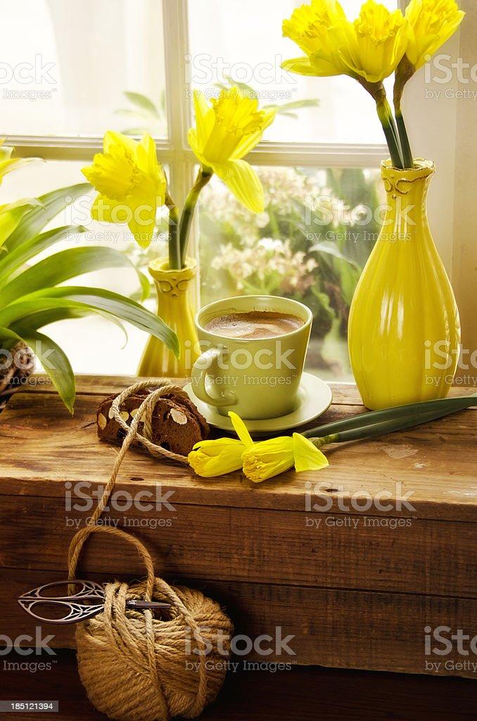 Espresso & daffodils stock photo