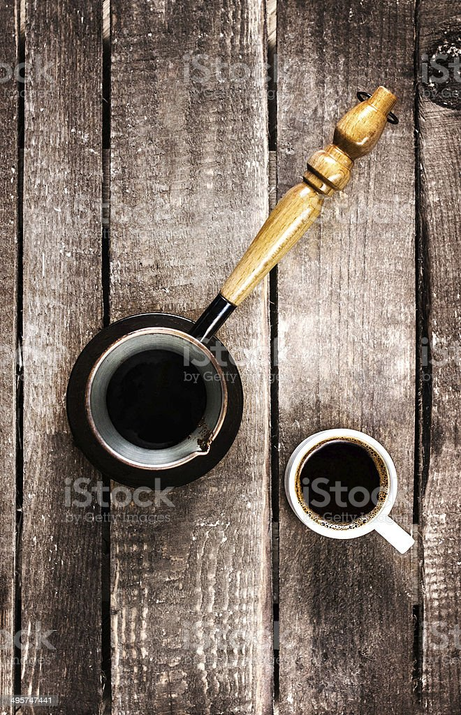 Espresso Coffee cup and Coffe pot over wood table royalty-free stock photo