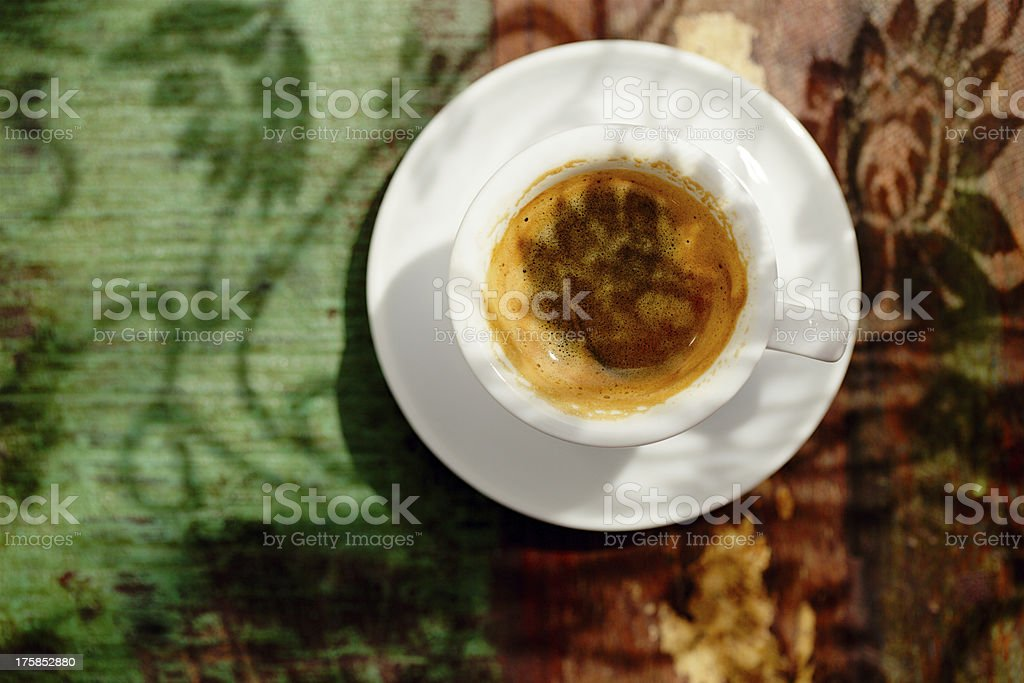 espresso coffee cup on rustic table with sun royalty-free stock photo
