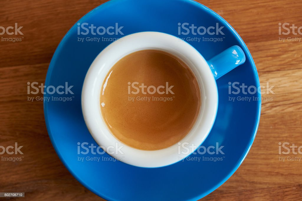 Espresso coffee in a blue cup seen from above stock photo