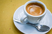 espresso coffee in a white cup close up