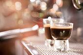 Espresso coffee in glass on espresso machine